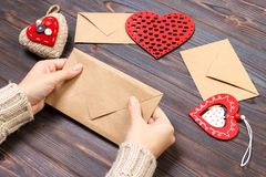 Girl packs a love letter for Valentine`s Day. Valentine day concept with copyspace.  Stock Photography