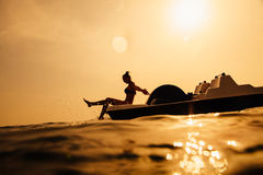 Girl on paddle boat with sunlight Stock Photography