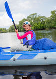 Girl with paddle and kayak Royalty Free Stock Photography