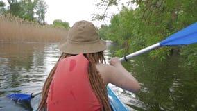 Female traveler on the kayak. Girl with paddle and kayak swim on big river, traveler on canoe stock video