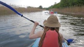 Female traveler on the kayak. Girl with paddle and kayak swim on big river, traveler on canoe stock footage