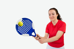 Girl paddle tennis. Portrait of a girl paddle tennis player standing and swatting the ball stock photo