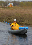 Girl with paddles a kayak and a house in the backg Stock Image