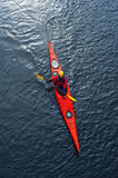 Girl paddles a kayak on the river. Man paddles a white kayak on the river near the shore, kayaking view from above Royalty Free Stock Photos
