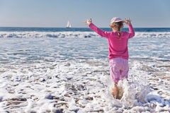 Girl paddling in the ocean Royalty Free Stock Image