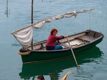 Girl paddling on an old sailing ship in Bermeo. Girl paddling on an old sailing boat in Bermeo, Bizkaia, Basque Country Stock Images