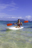 Girl paddling a surfski Royalty Free Stock Image