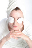 Girl with pads on her eyes Royalty Free Stock Image