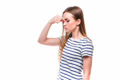 Girl with pain in nose. Stock Images