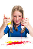 Girl and paint Stock Images