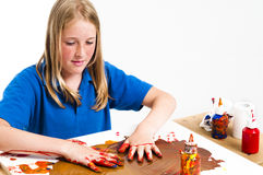 Girl and paint Stock Photos