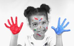 Girl and paint. Cute toddler girl with paint on both of her hands Royalty Free Stock Photos