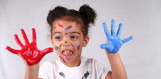 Girl and paint. Close up of a young toddler girls brown eyes Stock Image