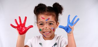 Girl and paint. Close up of a young toddler girls brown eyes Royalty Free Stock Images