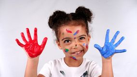 Girl and paint. Close up of a young toddler girls brown eyes Stock Photography
