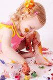 Girl in paint Stock Images