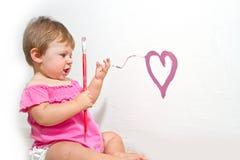 Girl paint on a board Stock Photos