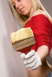 Girl with paint brush Stock Images
