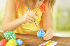 Girl paint Easter egg Stock Image