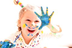 Girl with paint hands isolated on white Royalty Free Stock Photo