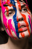 Girl with paint on her face Stock Photography