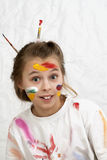 A girl with paint on her face Royalty Free Stock Images