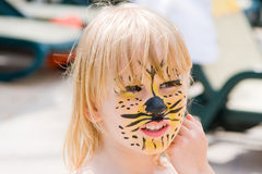 Girl with paint on his face. In the pool Royalty Free Stock Image