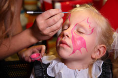 Girl paint for holiday Royalty Free Stock Photo