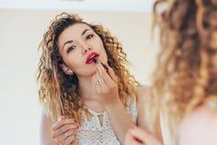 Girl paint lips red lipstick Stock Photo