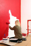 Girl with paint roller. Stock Photos