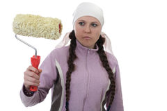 Girl with paint roller Stock Image