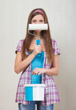 Girl with a paint roller Stock Photography