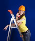Girl with paint rollers Stock Images
