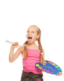 Girl with a paintbrush Stock Images
