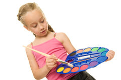 Girl with a paintbrush Royalty Free Stock Photo