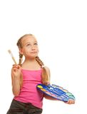 Girl with a paintbrush Stock Image