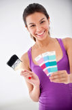 Girl with Paintbrush and Colour Swatch Stock Photo