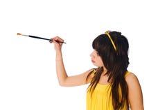 Girl with paintbrush on white background Royalty Free Stock Image