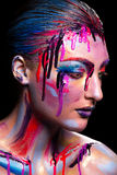 Girl painted different colors Royalty Free Stock Photography