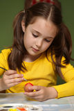 Girl painted Easter eggs Stock Photography