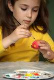 Girl painted Easter eggs Stock Photo