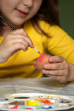 Girl painted Easter eggs Royalty Free Stock Images