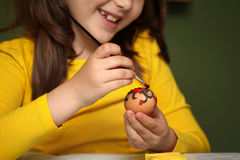 Girl painted Easter eggs Stock Photos