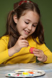 Girl painted Easter eggs Royalty Free Stock Photography