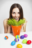 Girl and painted eggs. Excited woman searching for easter eggs in green grass Royalty Free Stock Photography