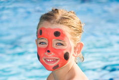 Girl with painted face Stock Photography