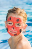 Girl with painted face Royalty Free Stock Photography