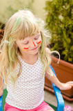Girl with painted face Stock Images