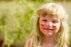 Girl with painted face Stock Image