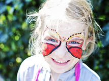 Girl with painted face butterfly Royalty Free Stock Images